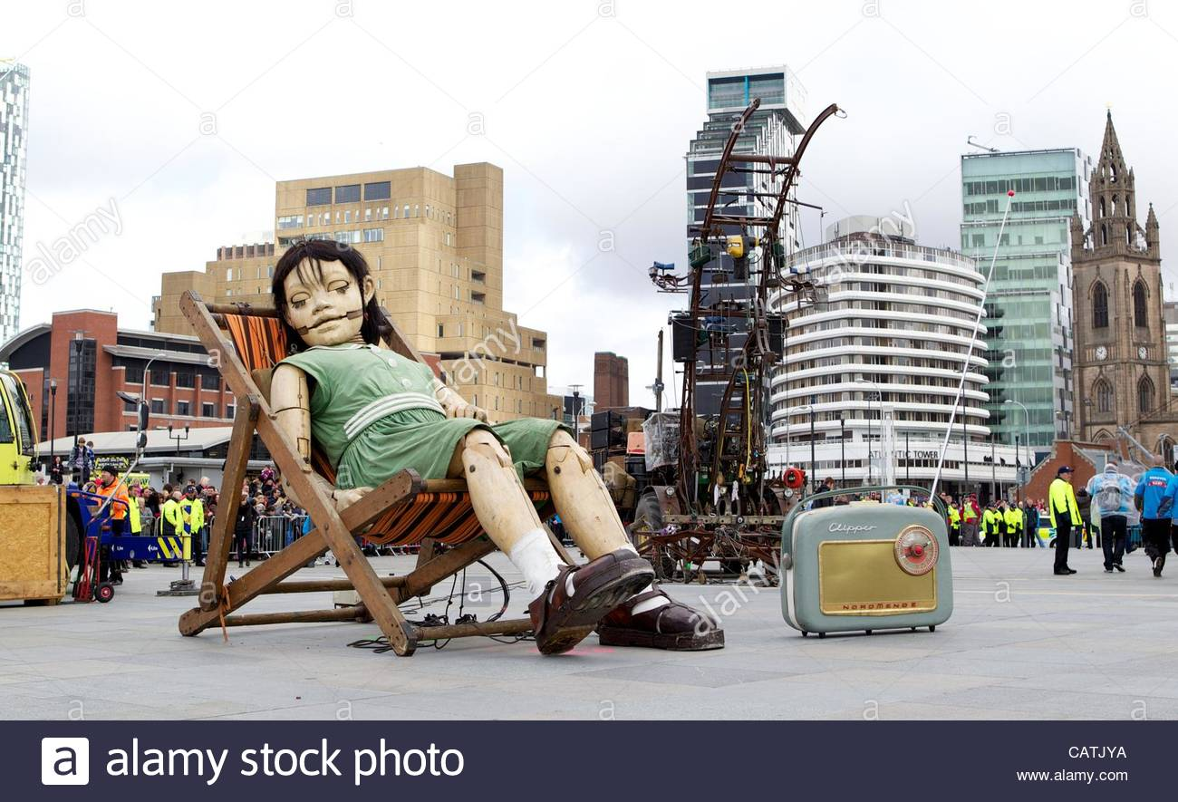LIVERPOOL, ENGLAND - Saturday, April 21, 2012: The Little Girl Giant, a 30ft tall marionette, sleeps at the Pier - Stock Image
