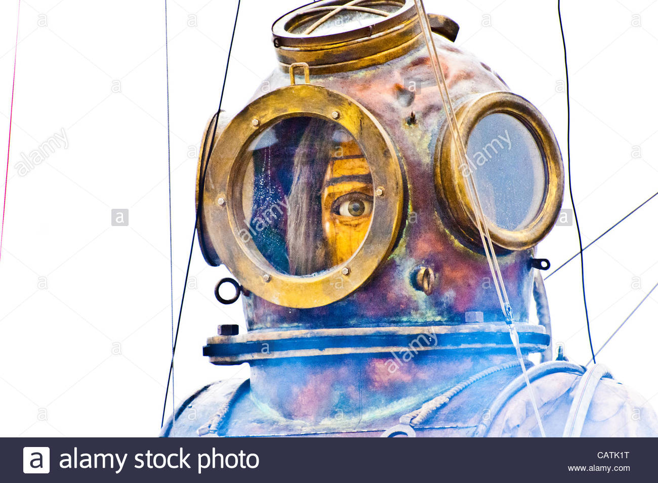 Giant Uncle waking up in Liverpool's Stanley Park, looking through his Diving Bell he scan see with one eye, - Stock Image