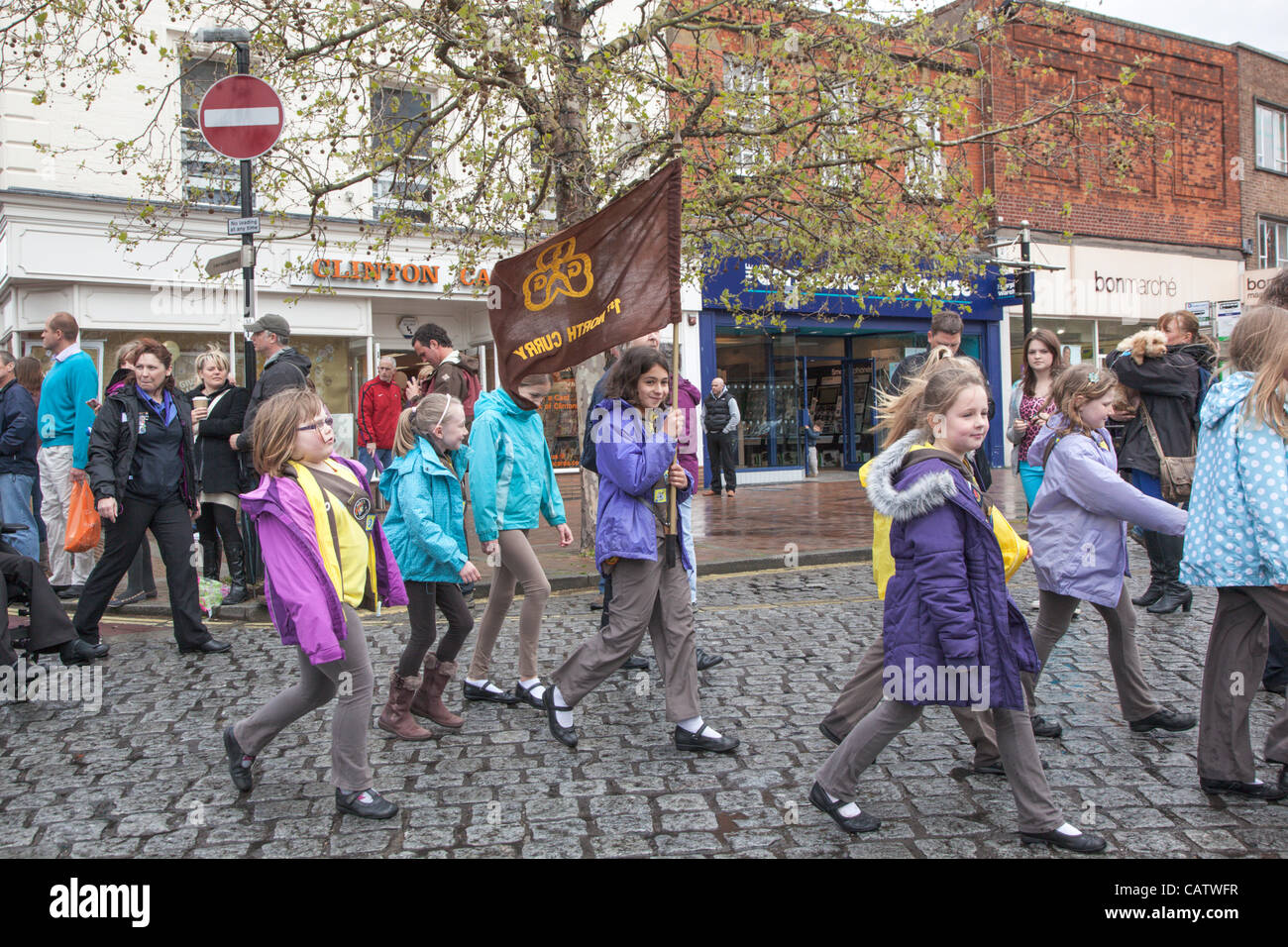 1st North Curry Brownies marching through Taunton town centre, Somerset, England on Sunday 22nd April 2012 to celebrate - Stock Image