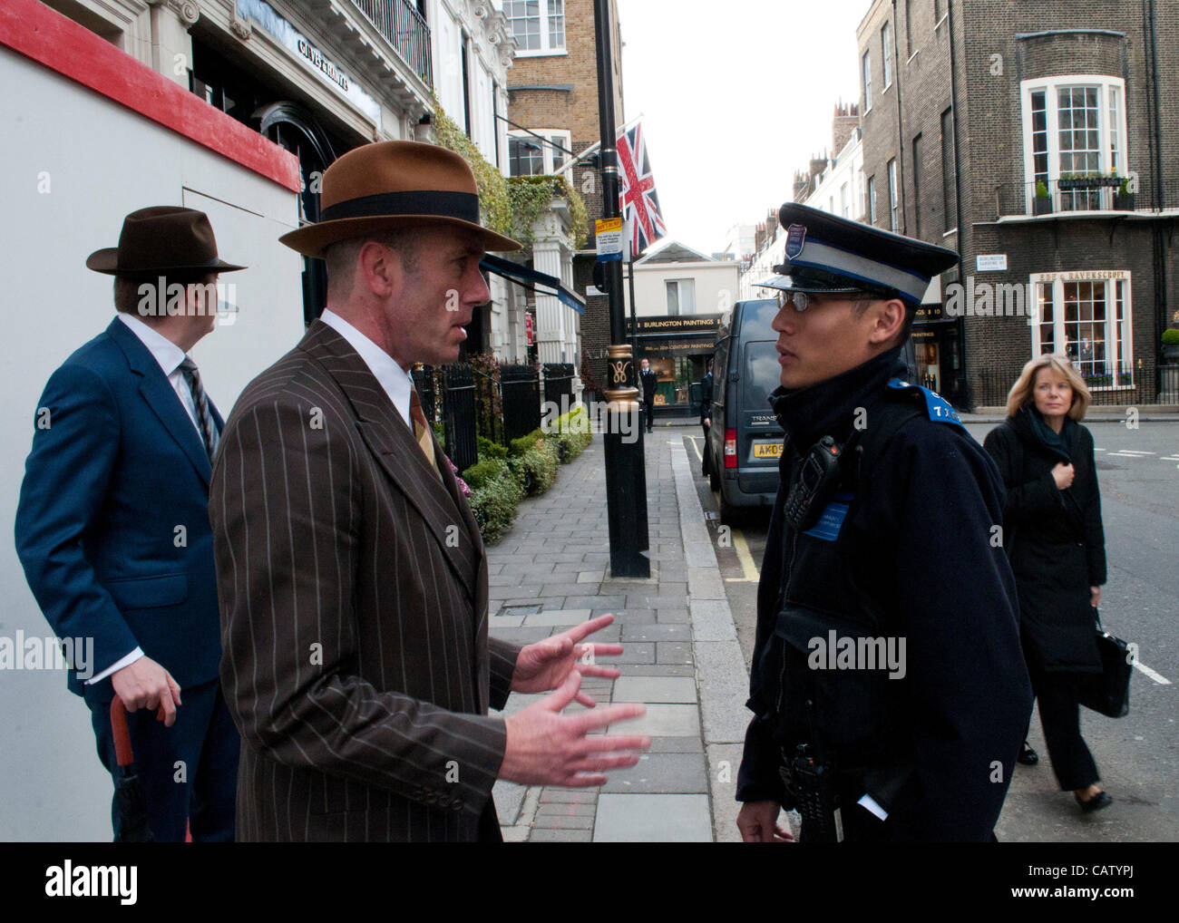 London, UK. 23/04/12. A gentleman of the Chap dealing politely with a Police Community Support Officer, as Chaps - Stock Image