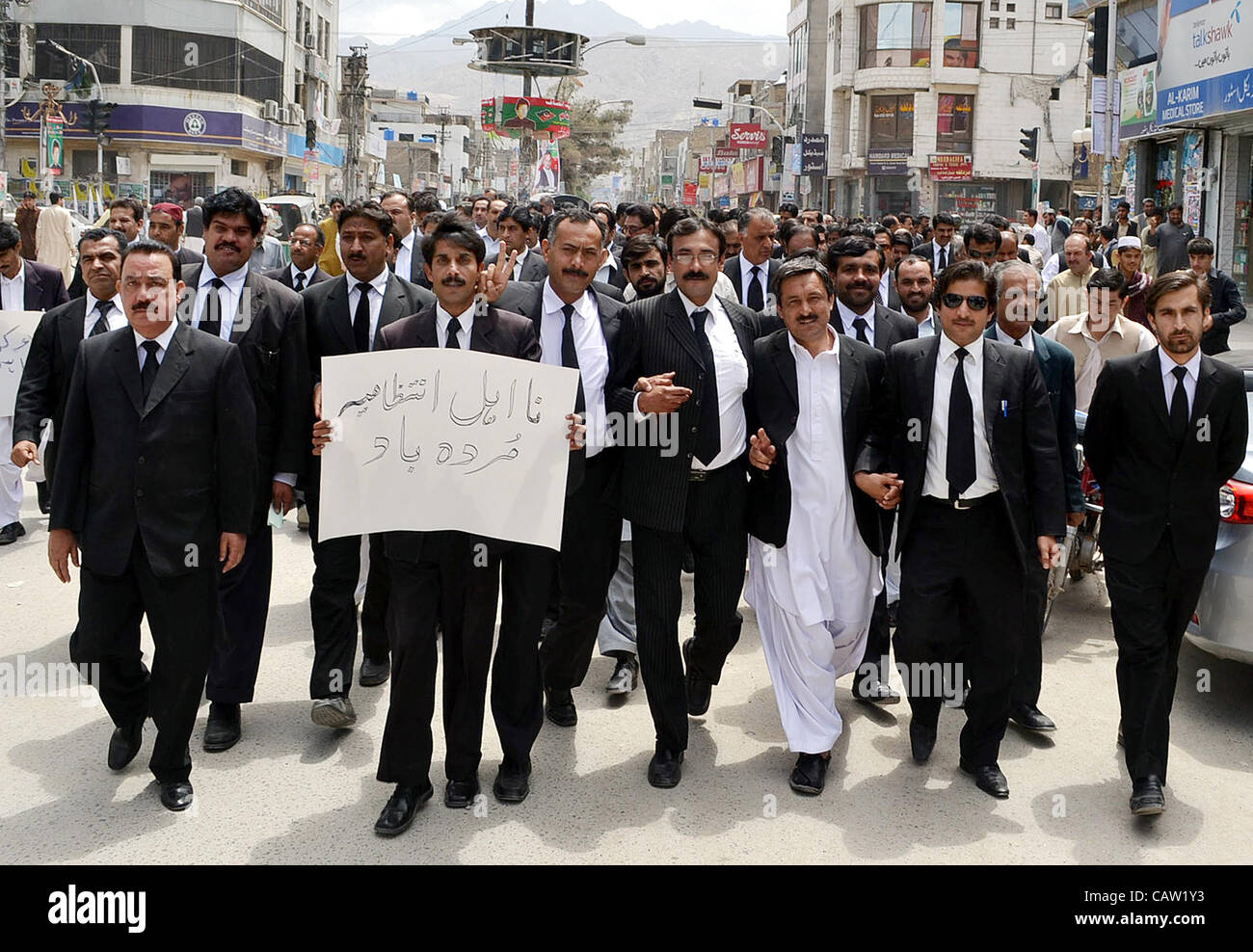 Supporters of Balochistan high court bar association (BHCBA) pass through a road during protest rally against non - Stock Image