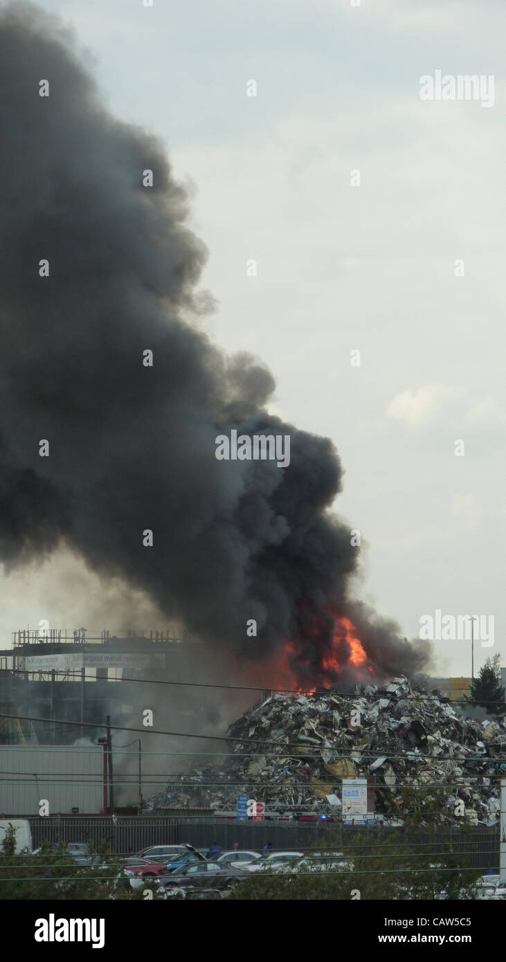 A fire breaks out at a recycling plant in Harlesden  North West London UK on 24 April 2012. - Stock Image