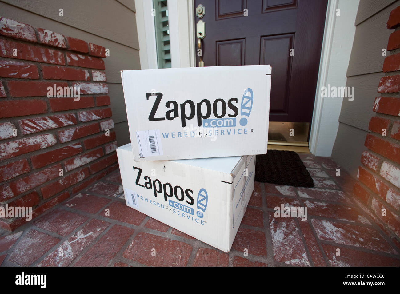 April 22, 2012 - Aliso Viejo, California, U.S. - White Zappos shipping boxes delivered to home in Southern California. - Stock Image