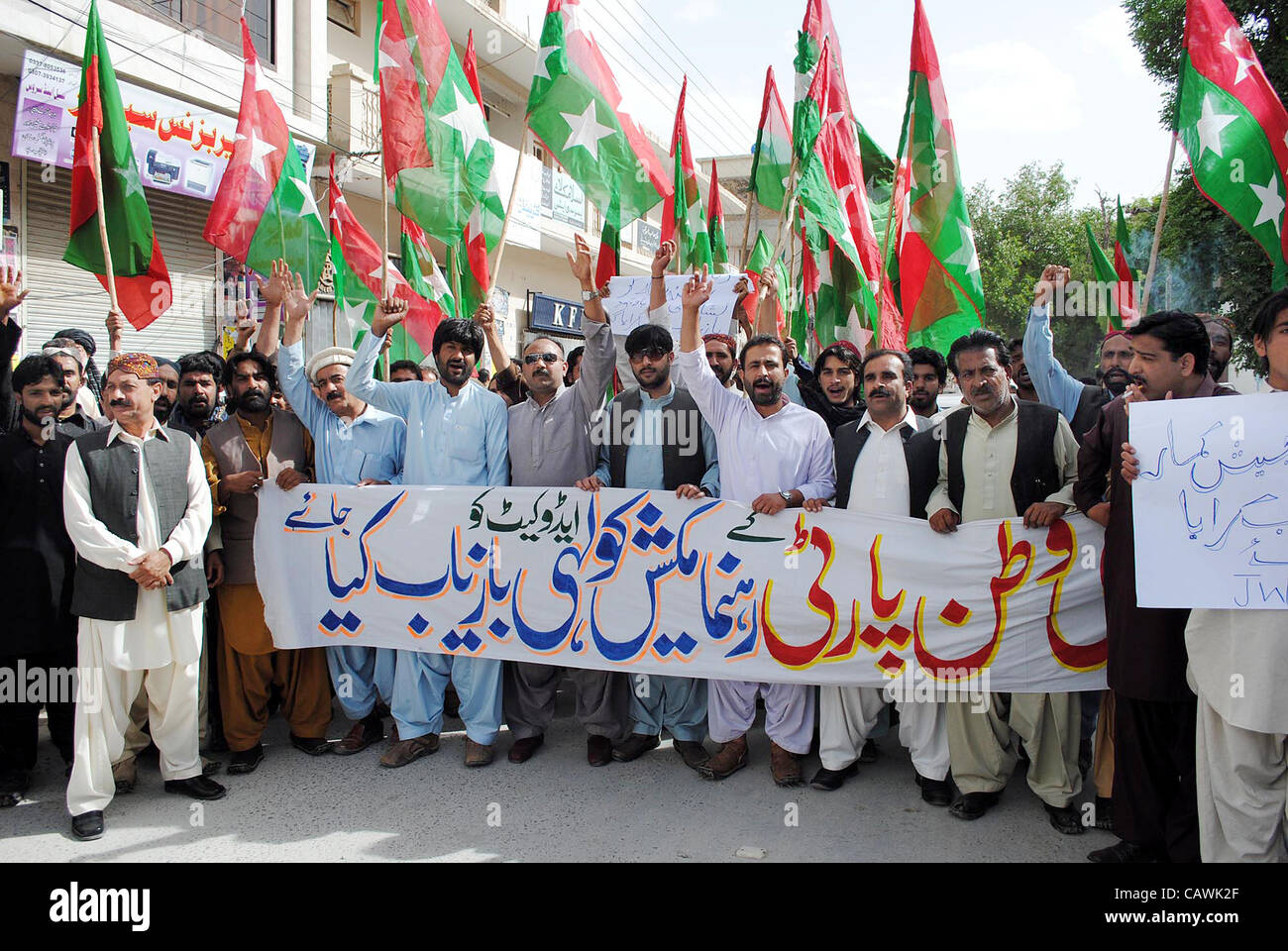 Supporters of Jamhori Watan Party (JWP) are protesting for recovery of Mukesh Kolhi Advocate during demonstration - Stock Image