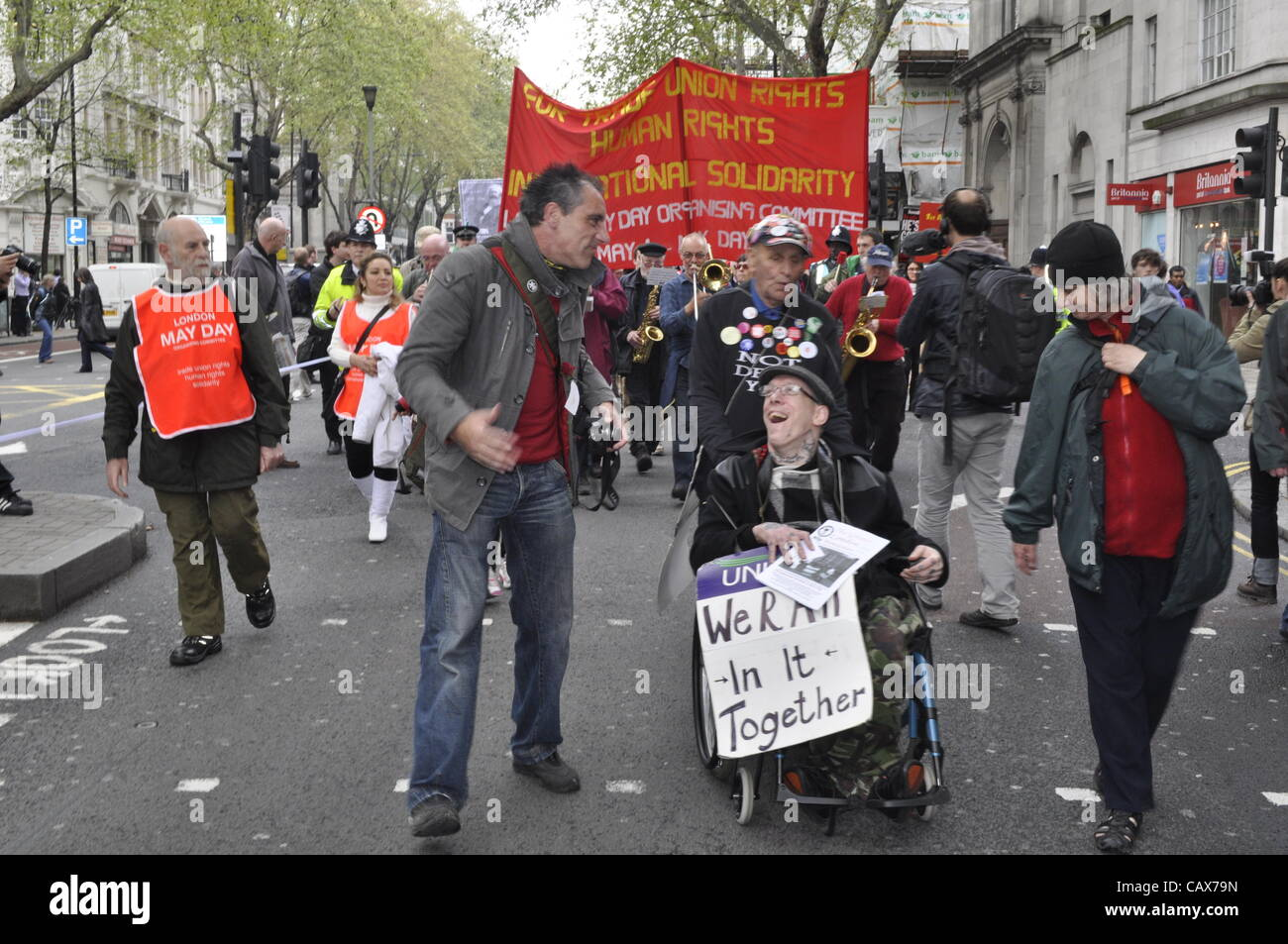 01 May 2012 London UK. Trade Union members and anti cuts protesters mingle on the annual May Day March. The March - Stock Image