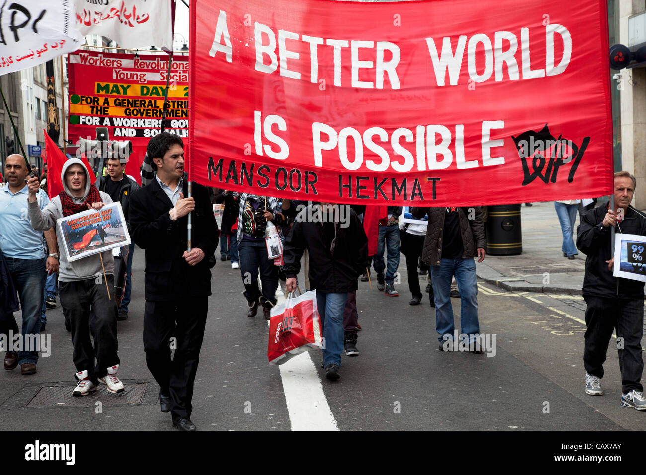 London, UK. 1 May, 2012. Demonstration by unions and other organisations of workers to mark the annual May Day or - Stock Image