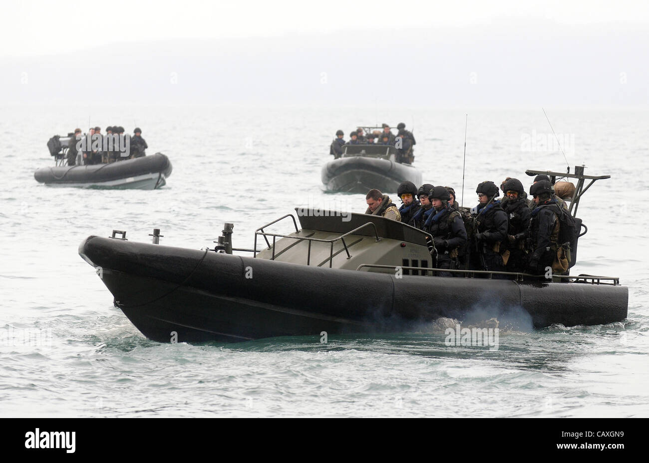 Royal Navy rapid response ribs, boat, speedboats carrying troops from HMS Bulwark - Stock Image