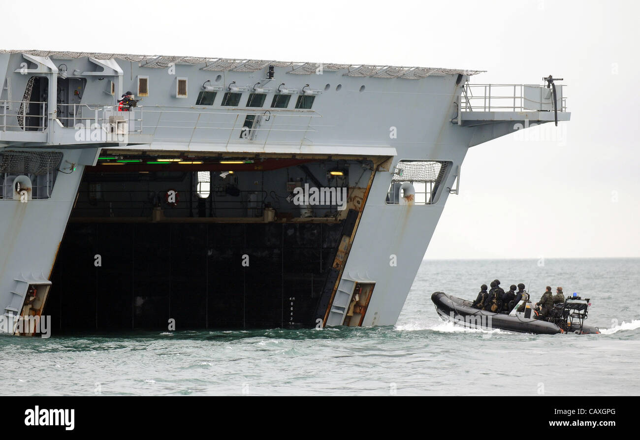 HMS Bulwark, Royal Navy flagship, Britain, UK, ribs carrying troops entering the back of the ship. - Stock Image