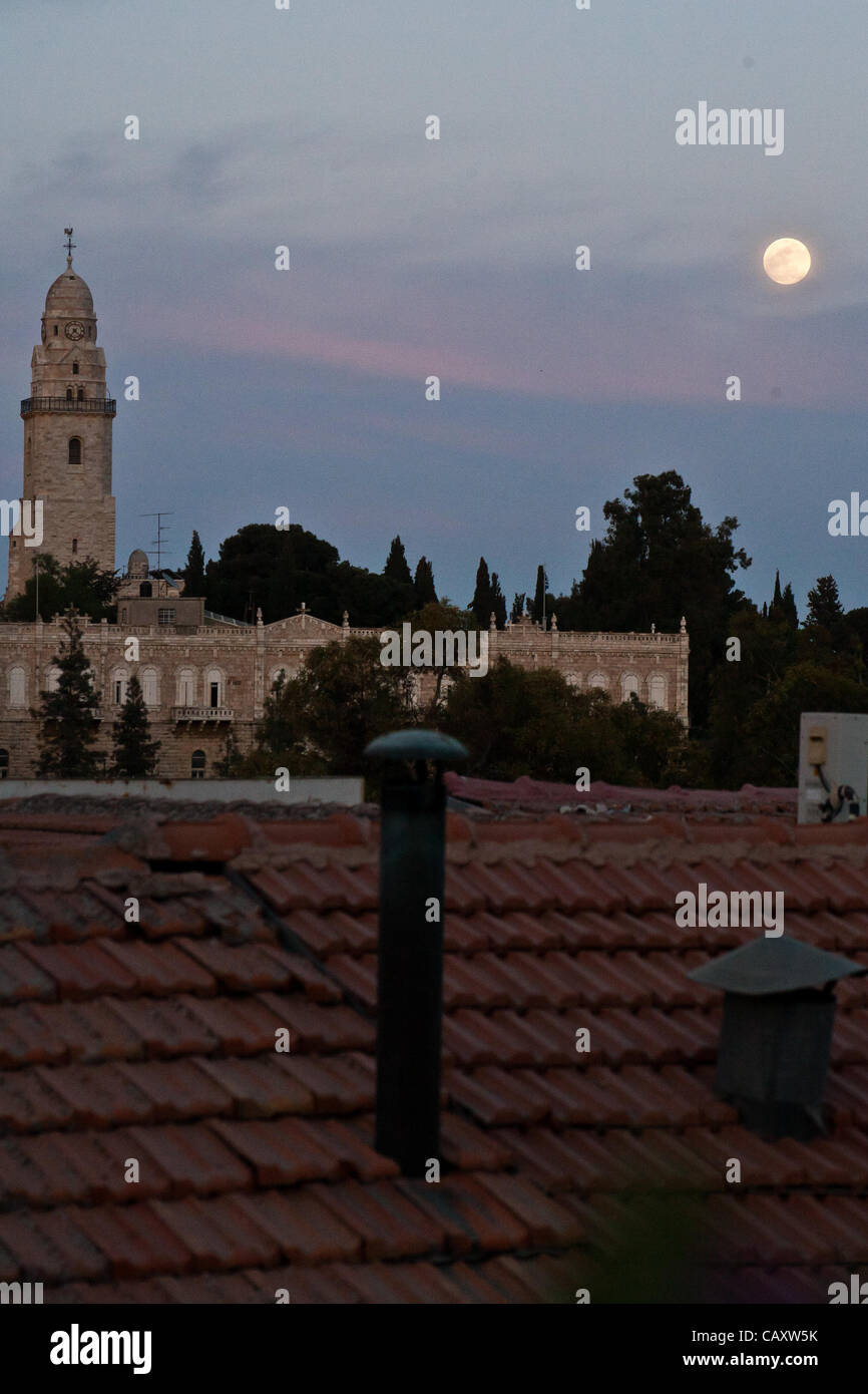 The biggest full moon of 2012, called the 'Supermoon' or perigee full moon, rises over the Hagia Maria Sion Abbey - Stock Image