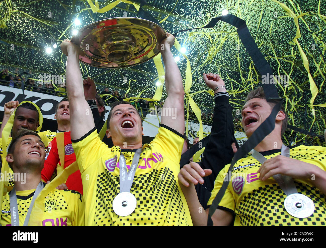 DORTMUND, GERMANY - MAY 05: Robert Lewandowski (C) of Dortmund lifts the trophy after winning the german championship - Stock Image