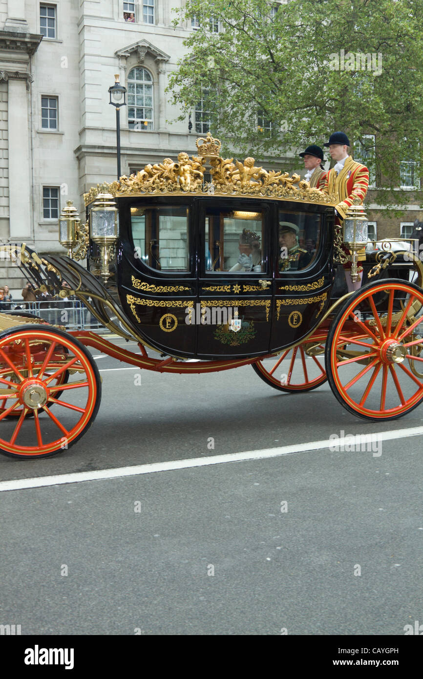 Wednesday 9th May, 2012. The Queen arrives in a horse drawn carriage to formally open the UK Parliament in Westminster. - Stock Image