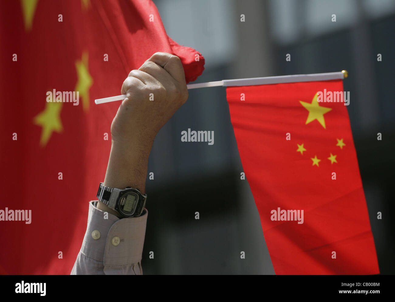 May 11, 2012 - Los Angeles, California, U.S. - A Chinese man holds a Chinese flag during a demonstration in front - Stock Image