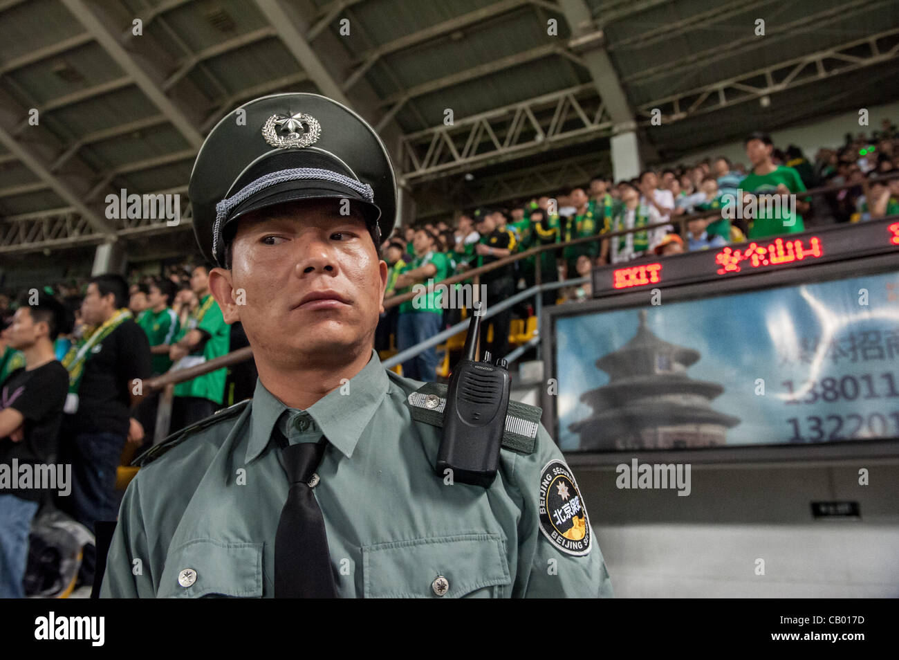Security guard in the Workers' Stadium during the match between the Beijing Guoan and Guizhou Renhe football - Stock Image