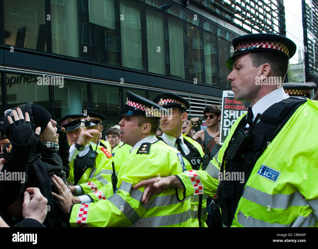 London, UK. 12/05/12. Police and Occupy protesters clash during a roving demonstration in the City of London area. - Stock Image