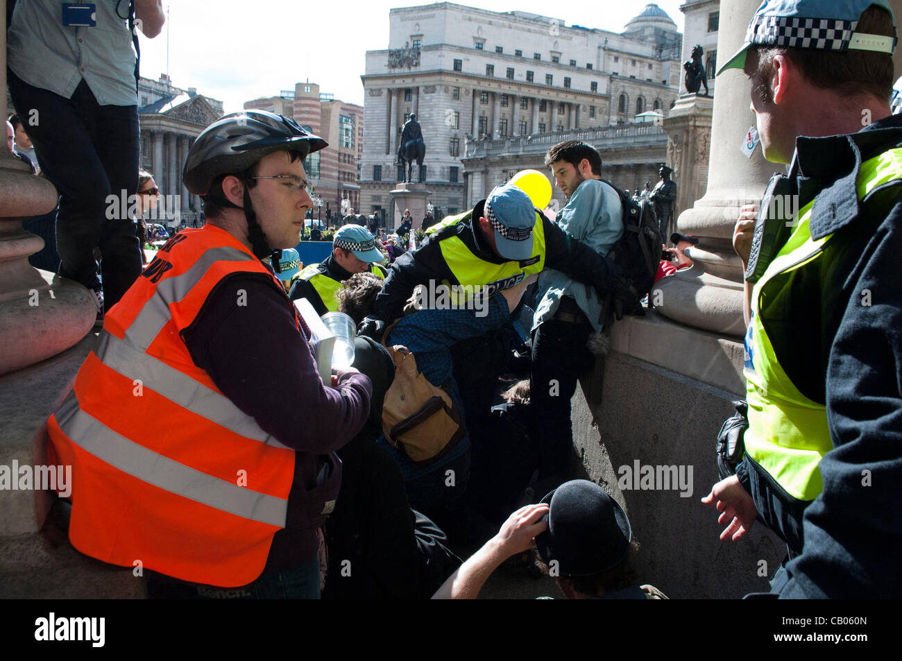 London, UK. 12/05/12. Officers of the Tactical Support Group and Occupy protesters clash on the Steps of the Royal - Stock Image