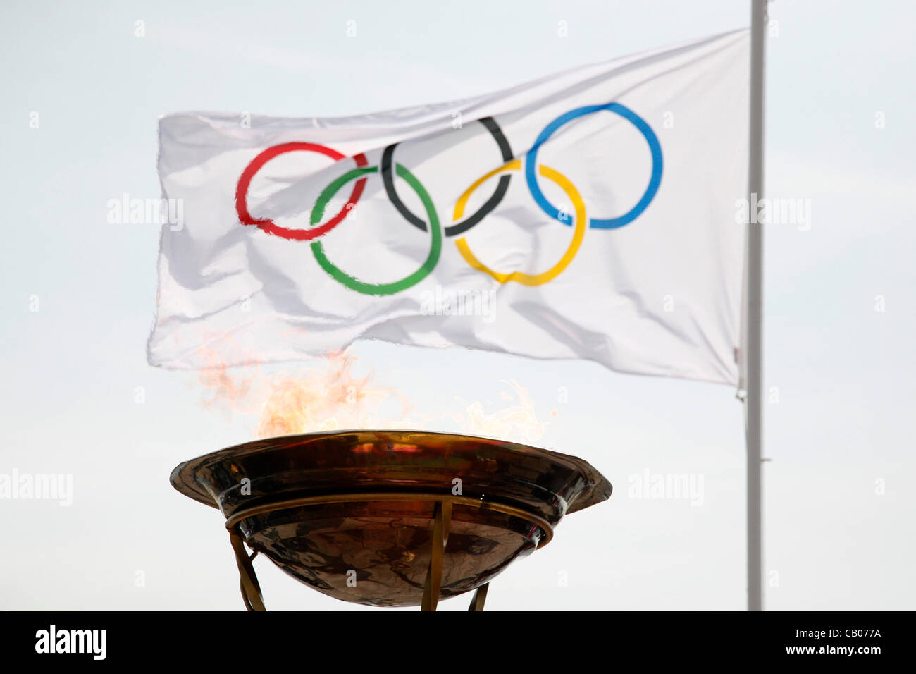The Olympic flame arrives in Thessaloniki. The torchbearer, Yota Economou lit the altar in front of the city's - Stock Image