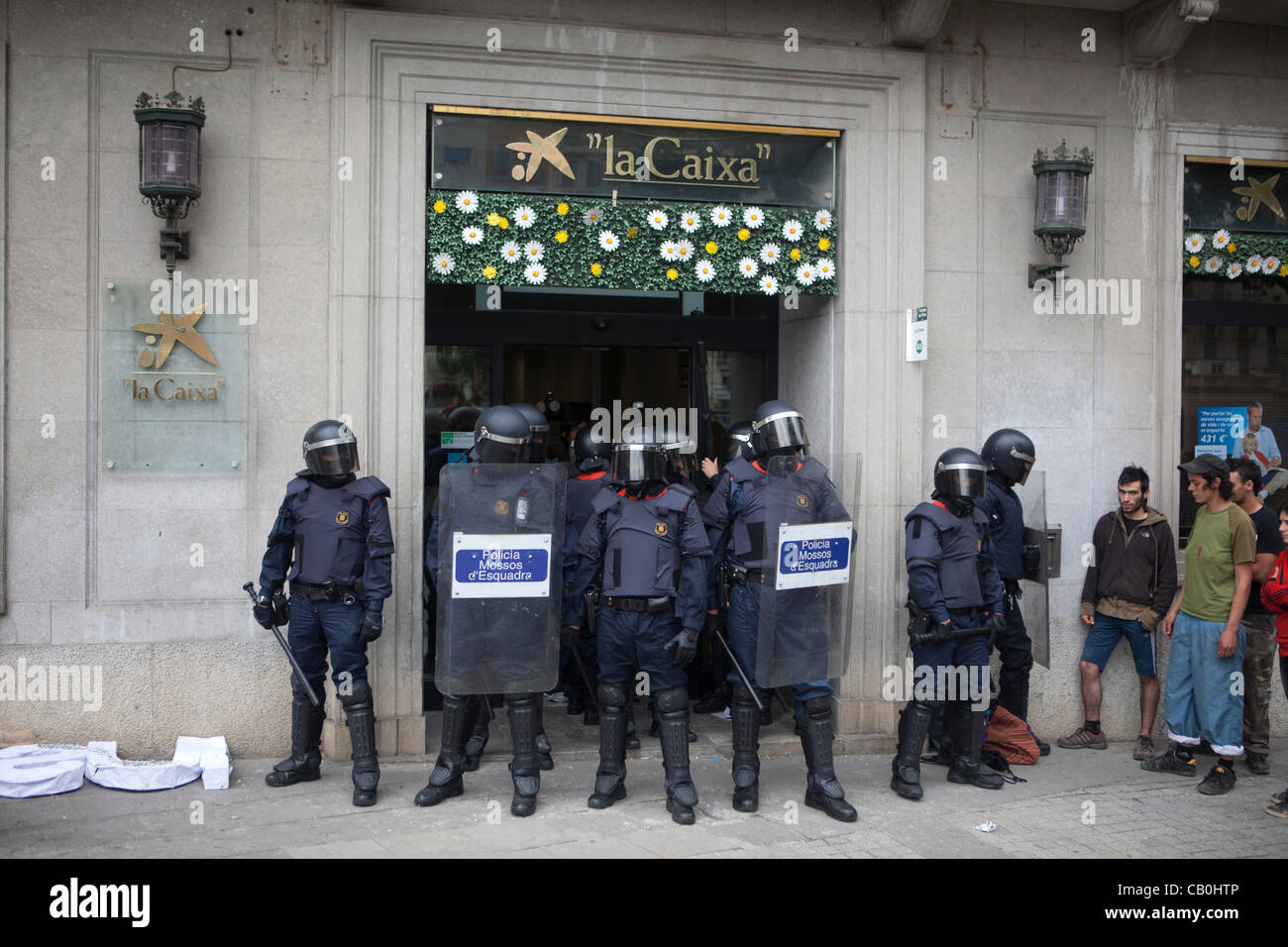 15M-anti-capitalist movement in Spain: Peaceful occupation of a branch of La Caixa bank in Spain Girona, young people - Stock Image