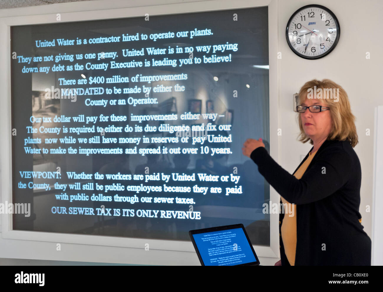 Speaking against Nassau County Executive's Plan to Privatize Sewage Treatment Plants are Claudia Borecky (shown) - Stock Image