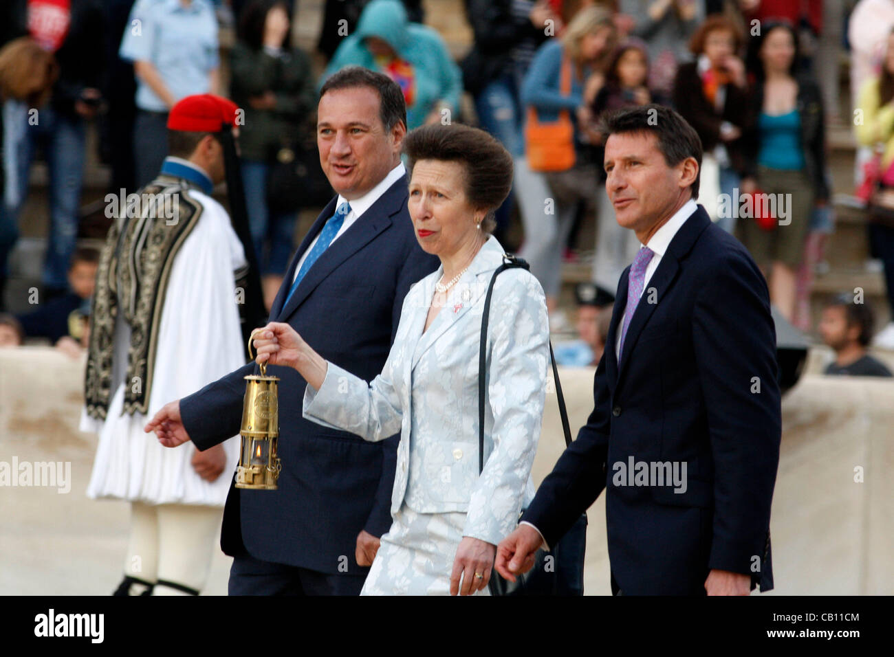 May 17, 2012 - Athens, Greece - Princess ANNE holds a lantern with the Olympic Flame next to her from right is SEBASTIAN - Stock Image