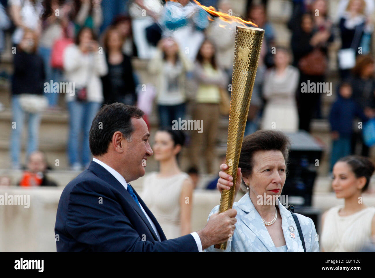 May 17, 2012 - Athens, Greece - Britain's Princess ANNE, holds the torch with the Olympic Flame at the handover Stock Photo