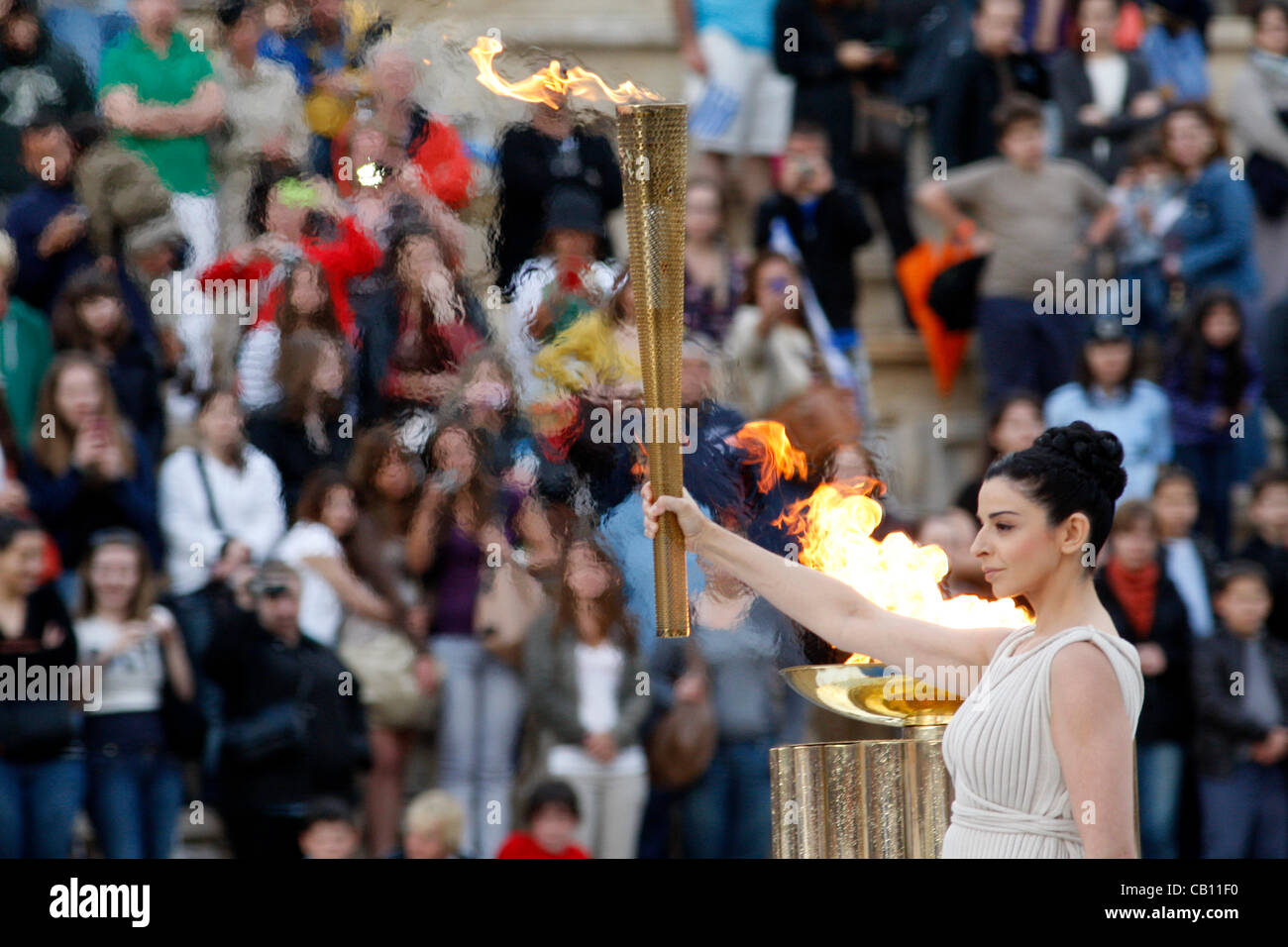 May 17 2012 Athens Greece. Actress INO MENEGAKI, dressed as a high priestess, lights the torch during the Olympic - Stock Image