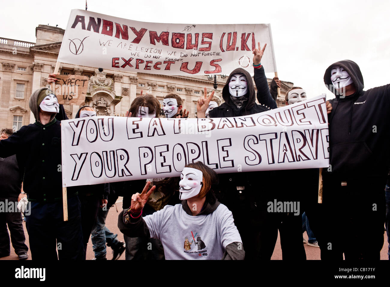 LONDON, UK - 18th May 2012: Occupy London and Anonymous protesters in front of Buckingham Palace denouncing the - Stock Image