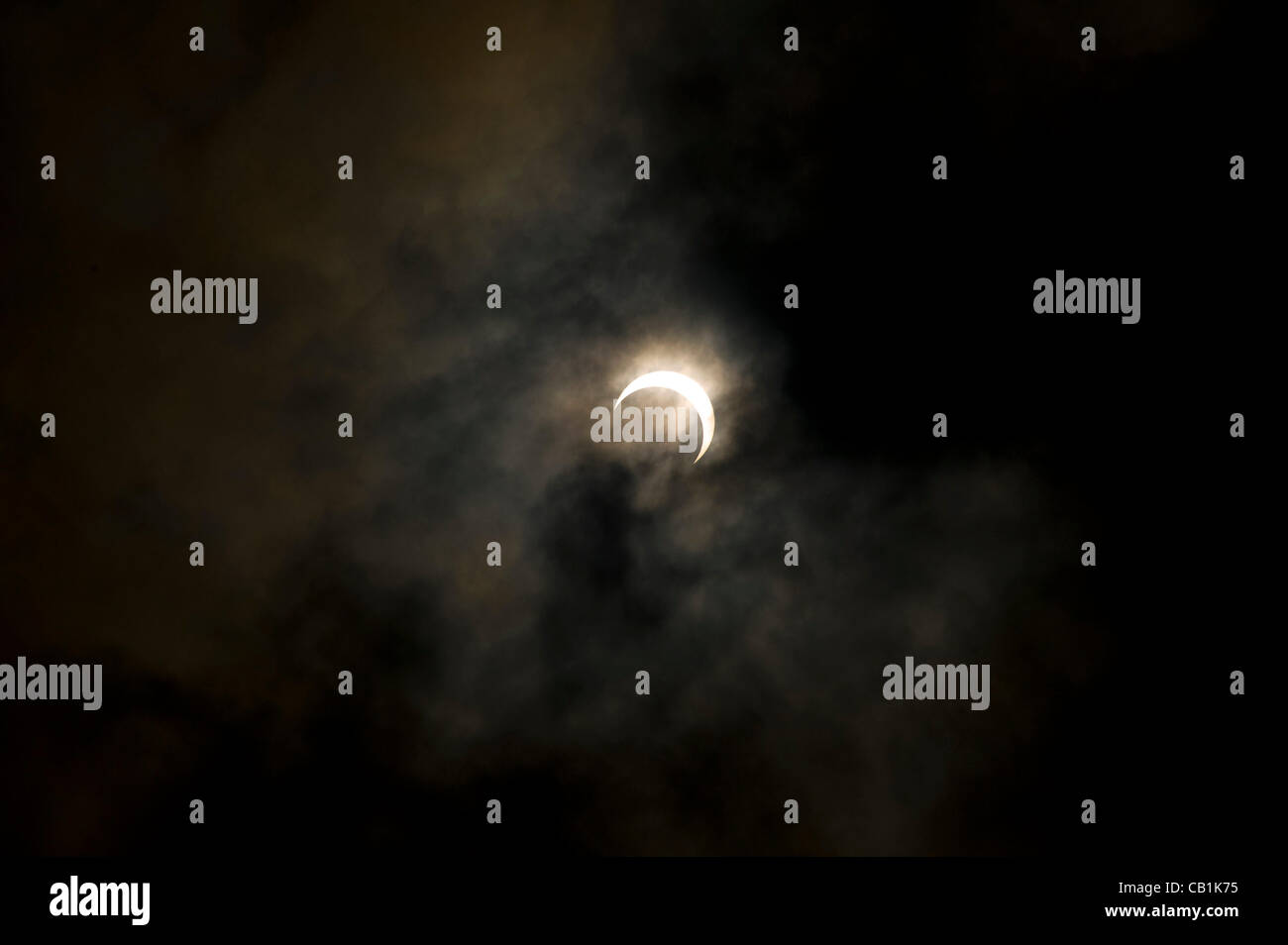 Photo shows the eclipse that crossed the skies of Tokyo and across Asia on Monday 25 May 2012. The annular solar - Stock Image