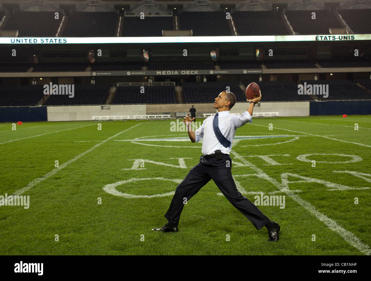 US President Barack Obama throws a football at the 50-yard-line at Soldier Field following the NATO Summit working - Stock Image