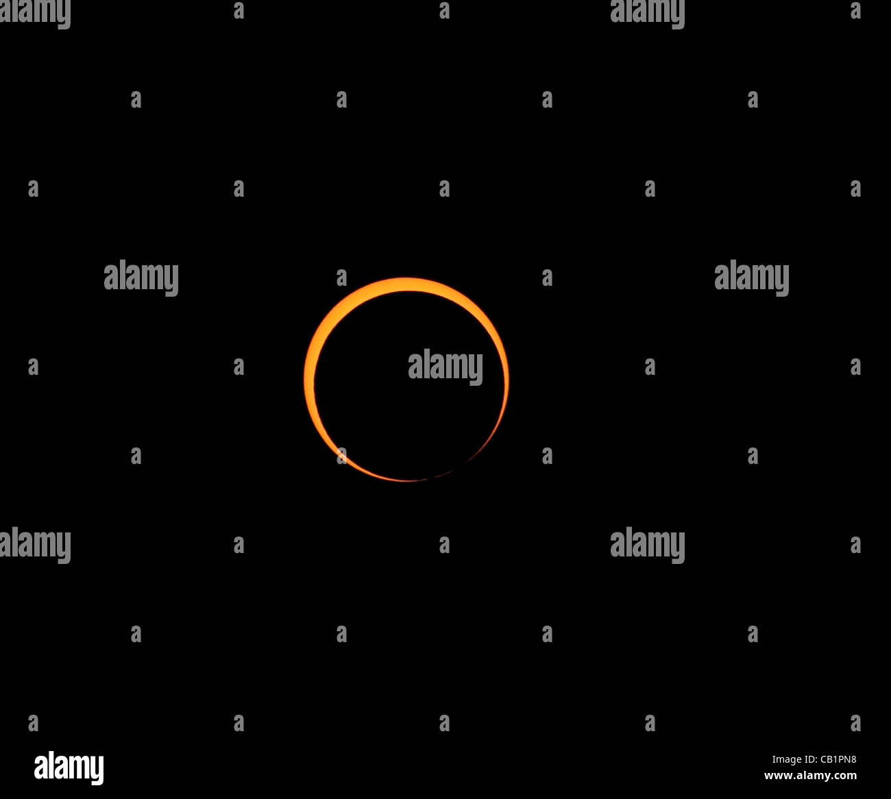 Sunday May 20 2012, the moon nearing maximum coverage of the sun during the annular eclipse. As seen from Rainbow Stock Photo