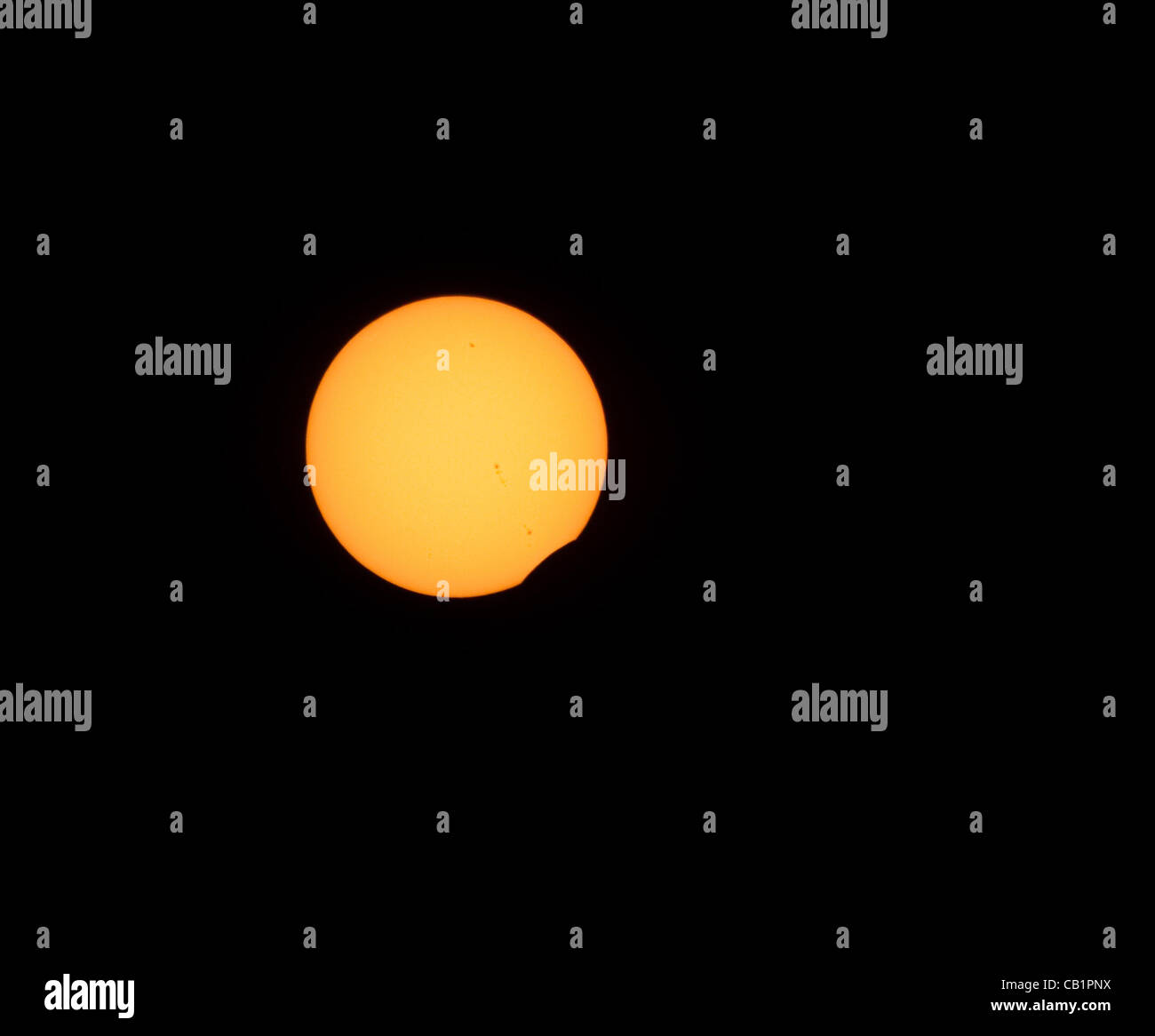Sunday May 20 2012, the moon starts to pass in front of the sun on its was to create an annular eclipse as seen Stock Photo