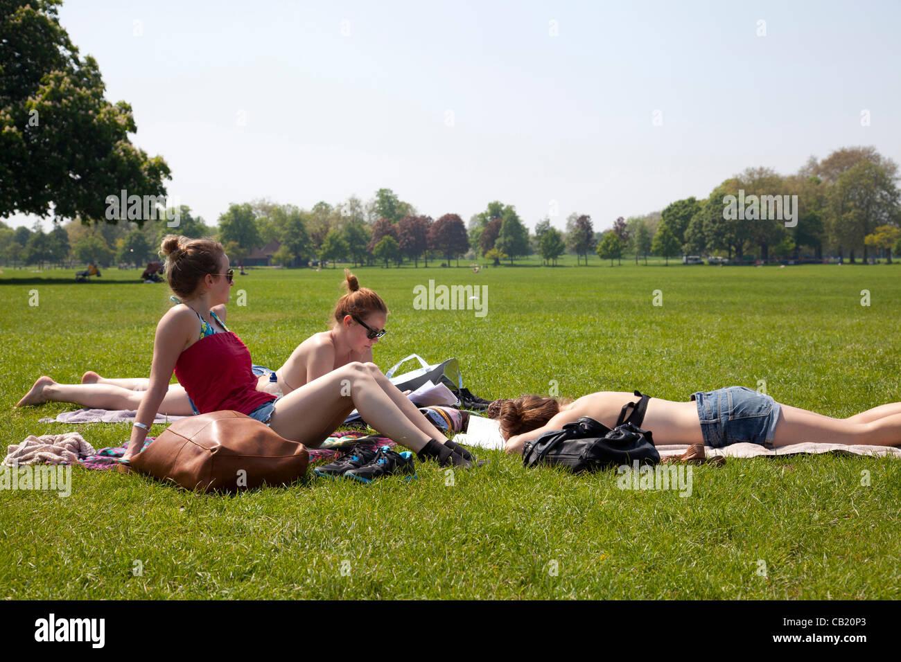 Tuesday 22nd May 2012. Group of girls enjoying Clapham Sunshine, London, UK. - Stock Image