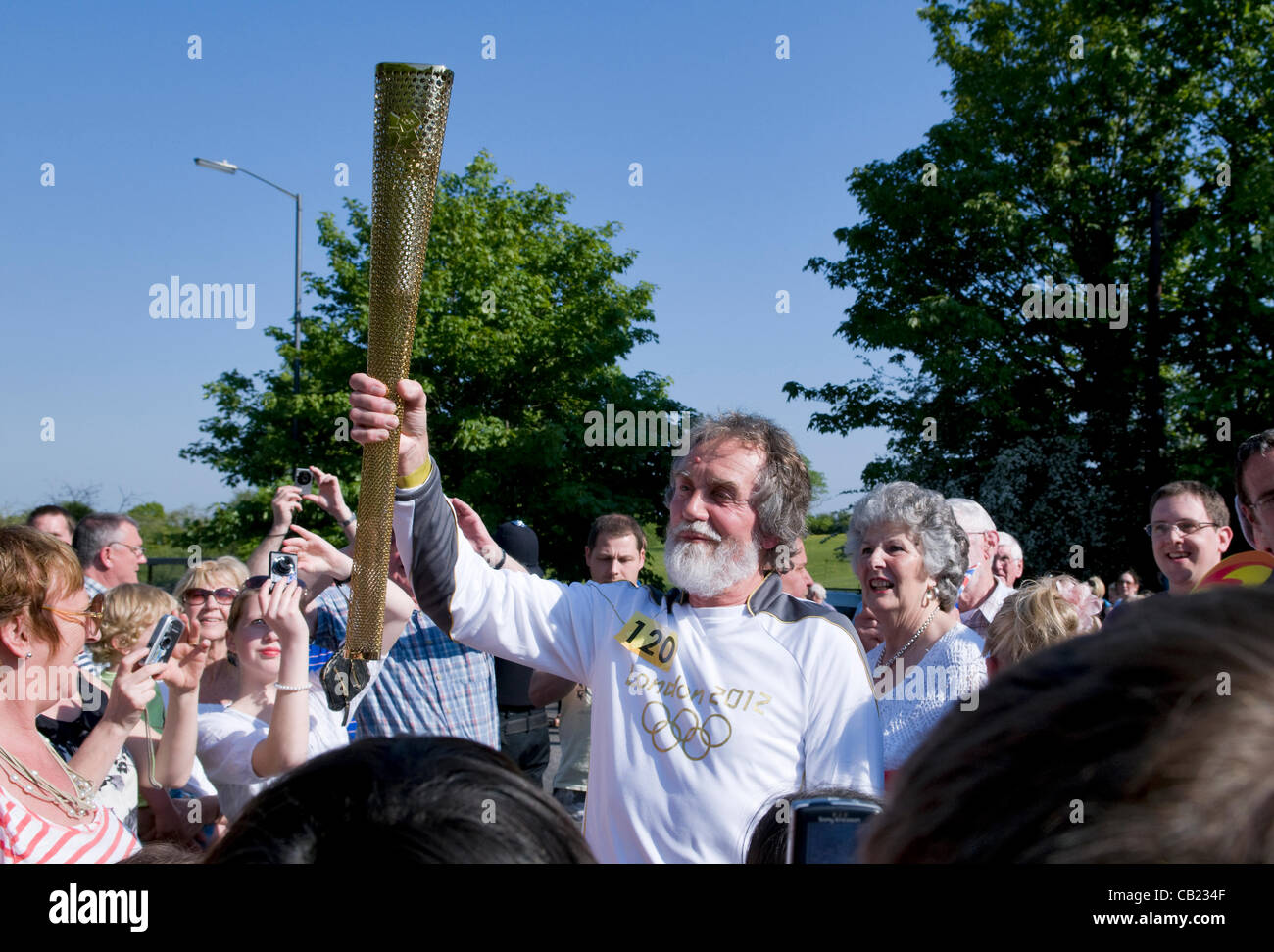 Olympic torch relay team at Longwell Green, Bristol, UK.  22nd May 2012. - Stock Image