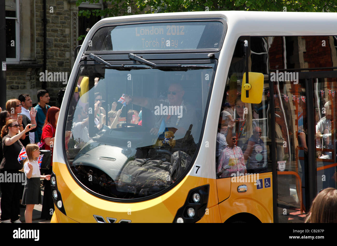 Wednesday, May 23rd 2012.  Swindon, Wiltshire, England, UK. The Olympic Torch Relay coach passes through Bath Road - Stock Image