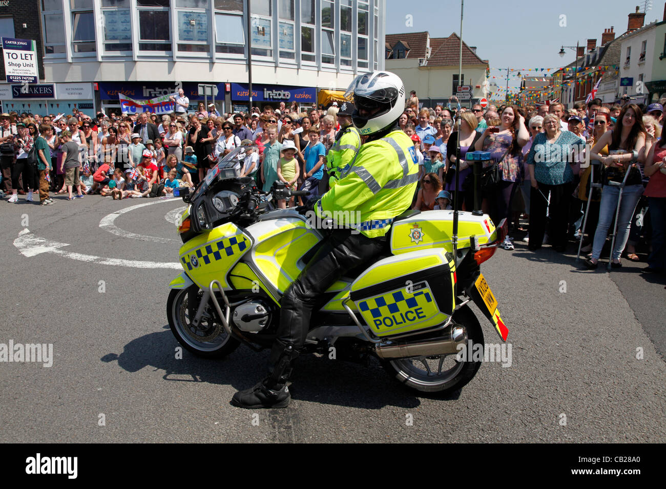 Wednesday, May 23rd 2012.  Swindon, Wiltshire, England, UK. Police patrol bike waits ahead of the Olympic Torch - Stock Image