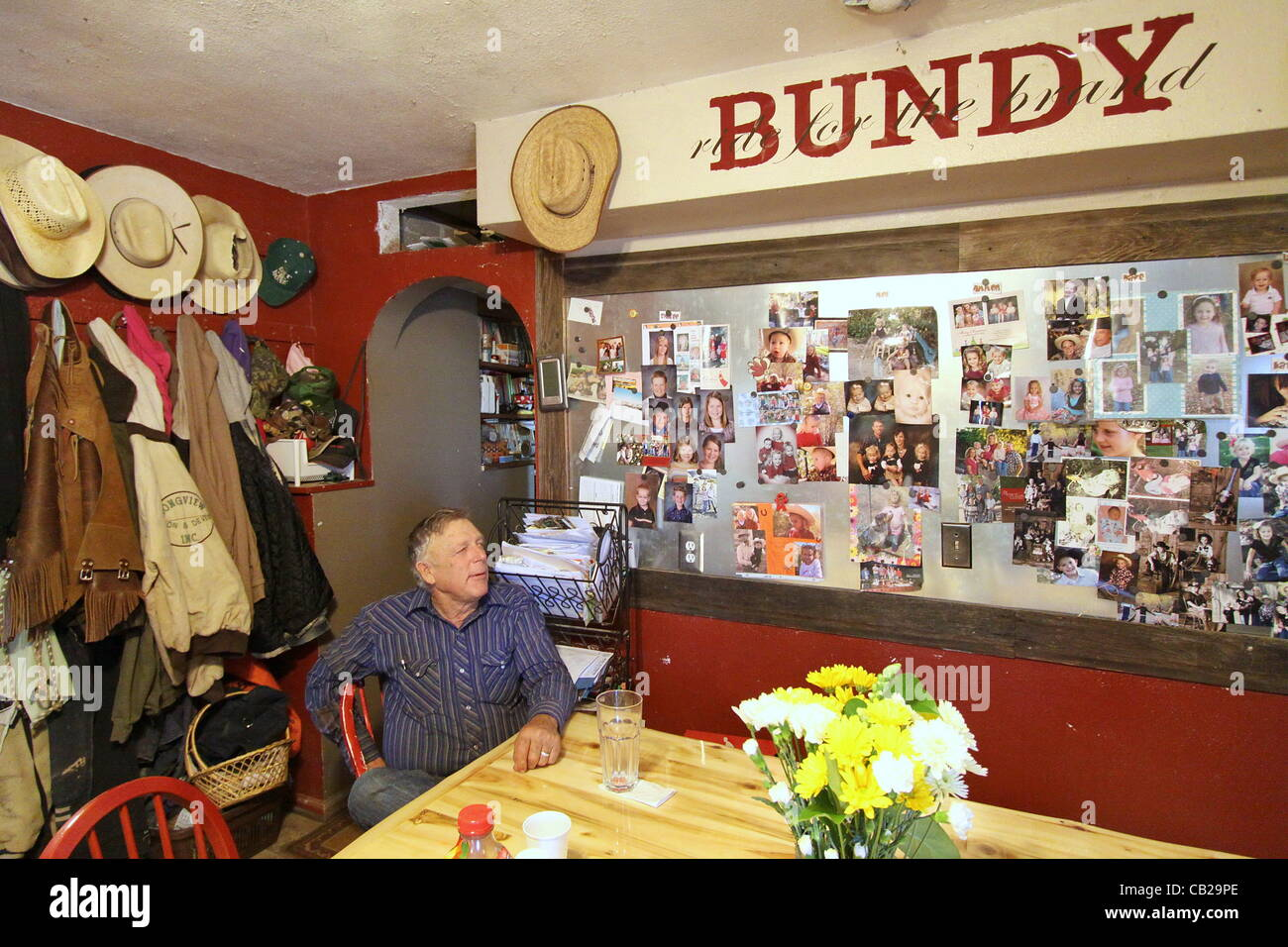 May 16, 2012 - Riverside, NV, U.S - With photos of his large family covering the wall, Cliven Bundy sits in the - Stock Image