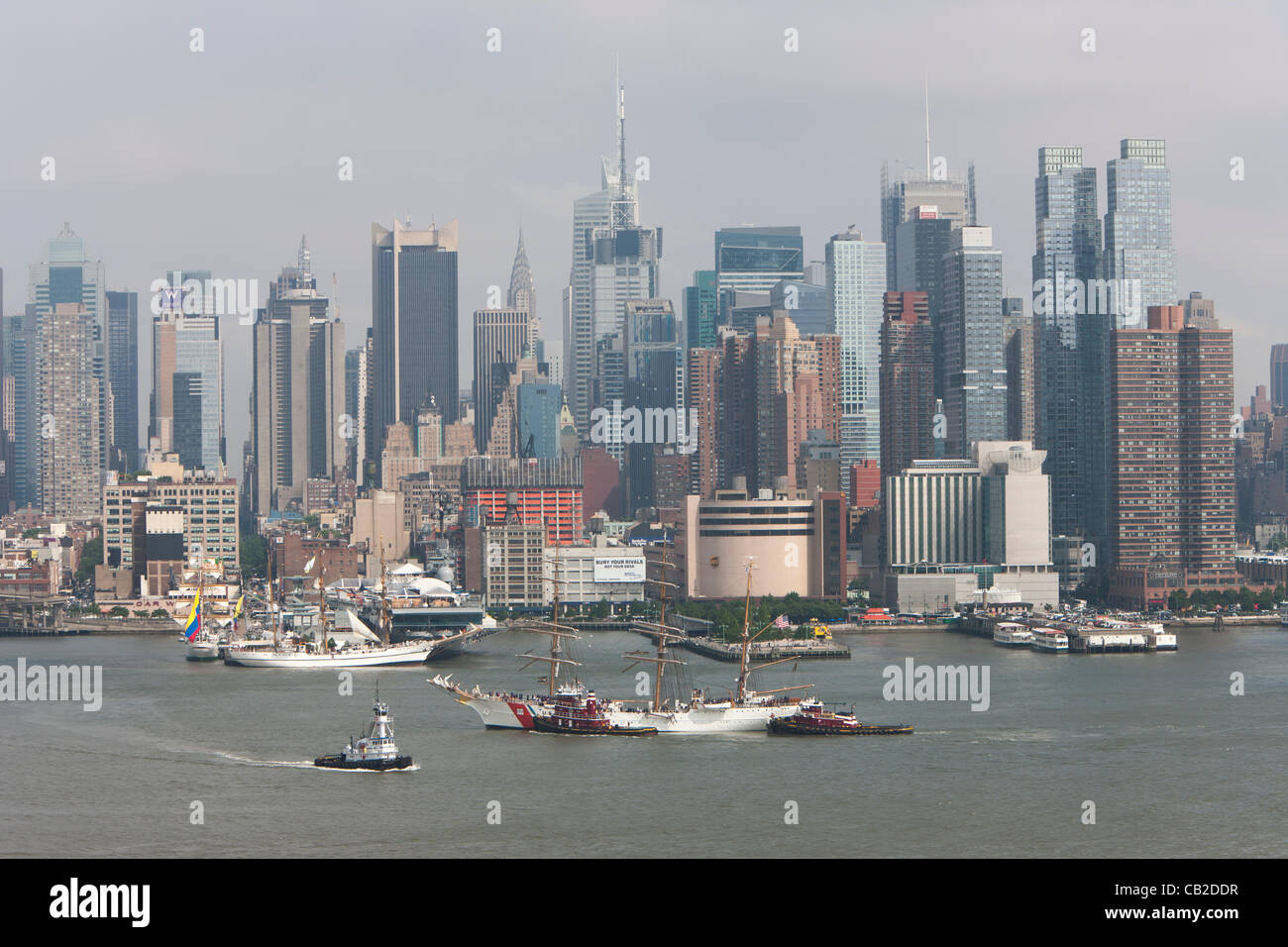 US Coast Guard Barque Eagle participates in the Parade of Sail on the Hudson River with other Tall Ships near the - Stock Image