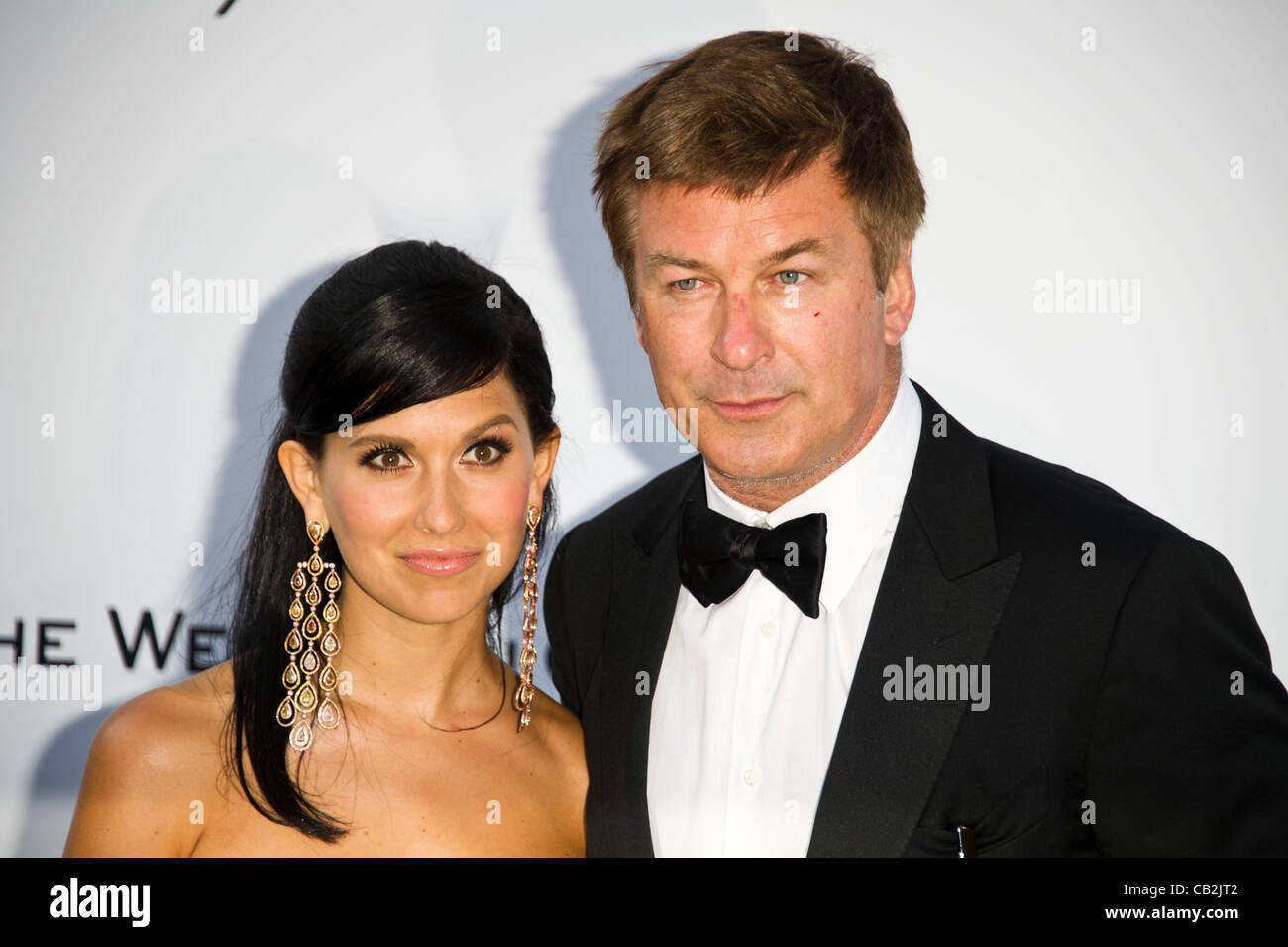 Alec Baldwin (actor) and girlfriend Hilaria Thomas at arrivals for the amfAR Cinema against AIDS charity auction Stock Photo