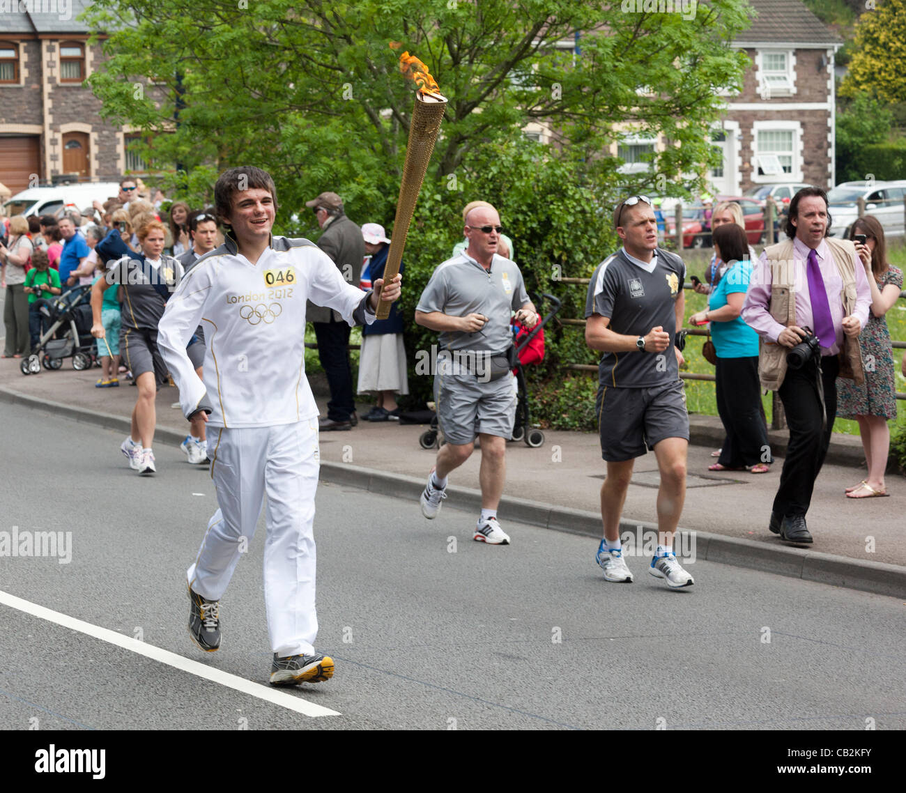 Sean Lewis age 16 from Llanbradach carryng the flame during the torch relay for the London 2012 Olympics through - Stock Image