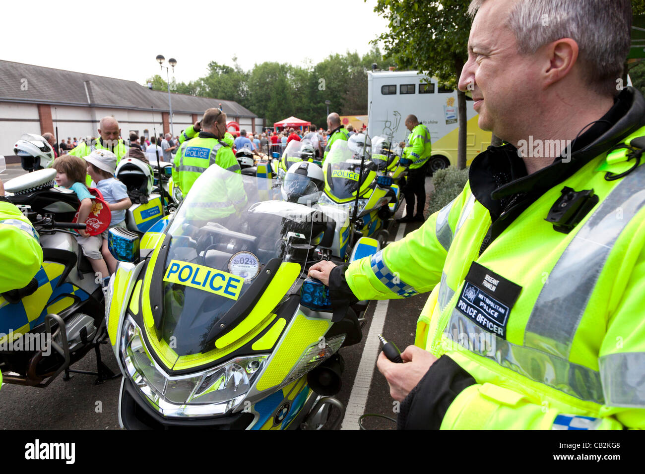 Sgt Franklin of the Metropolitan Police force during a break in security cover at an event in Abergavenny, Wales, - Stock Image