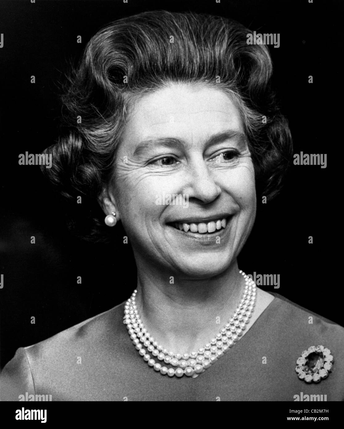 HM Queen Elizabeth II at a semi-formal function in 1975 Copyright owned photograph by Brian Harris. - Stock Image