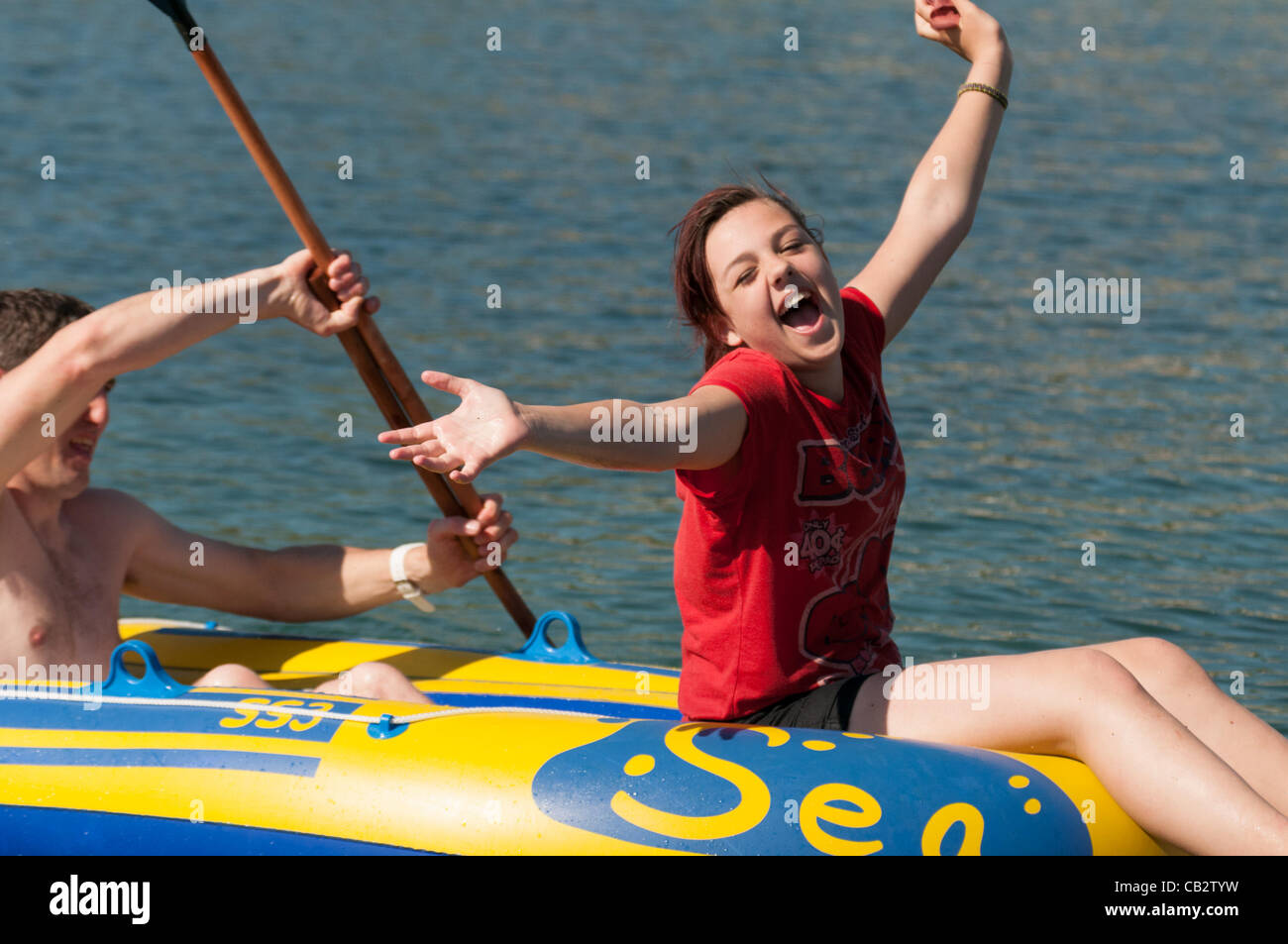May 26 2012:  As temperatures reach the high 20's celsius, young people enjoy the hot sunny weather in the sea - Stock Image