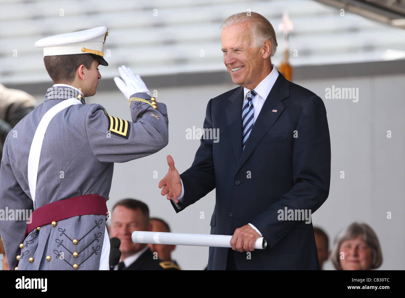 A graduating cadet from the US Military Academy class of 2012 receives his diploma from Vice President Joe Biden - Stock Image