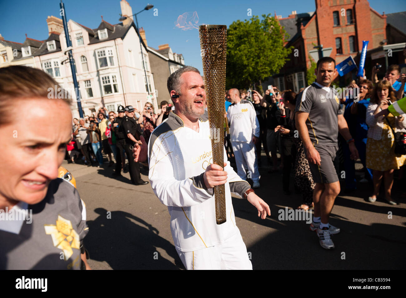 On day 10 of the Olympic torch relay through the United Kingdom, Radio 1 DJ CHRIS MOYLES carries the iconic flaming - Stock Image