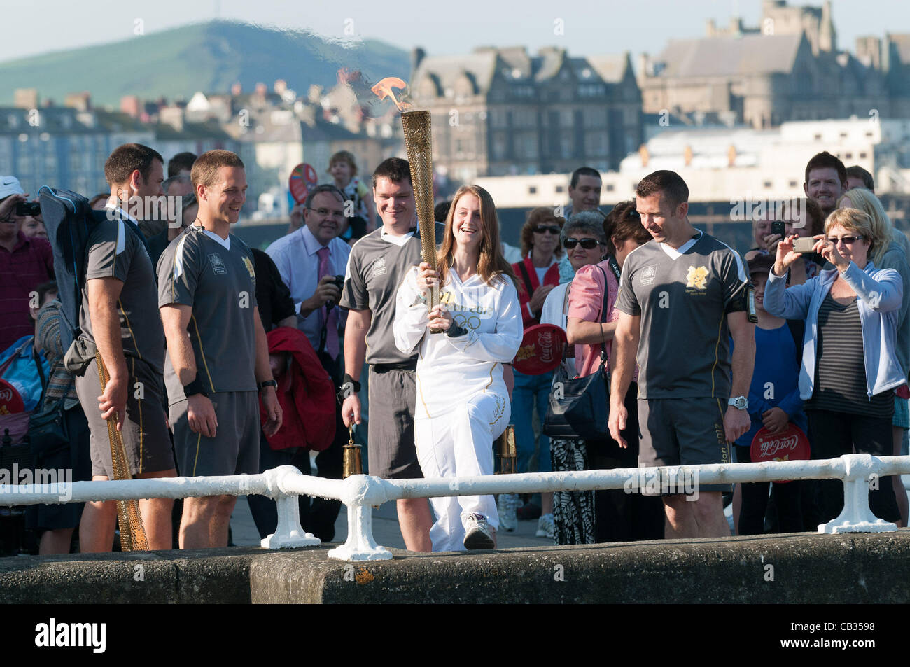On day 10 of the Olympic torch relay through the United Kingdom, local school pupil CARWEN RICHARDS carries the - Stock Image