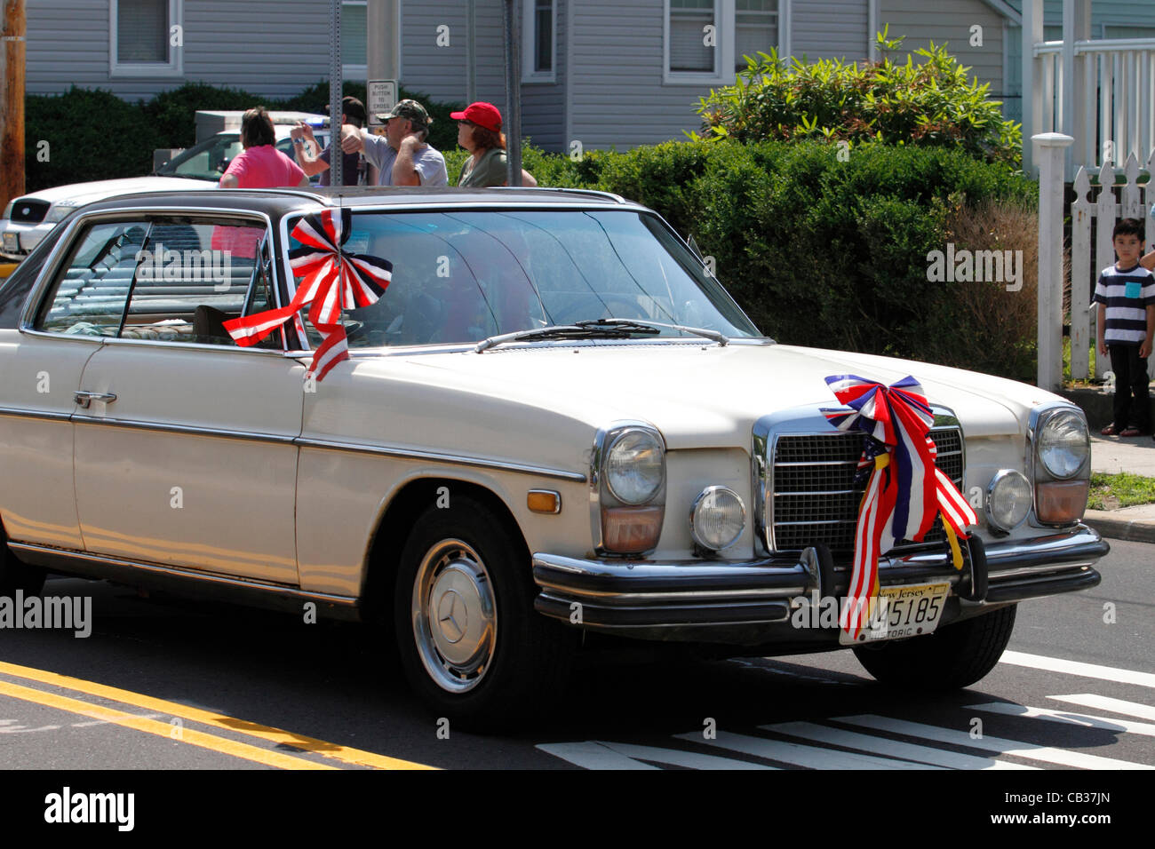Vintage Mercedes Benz Decorated With Red White And Blue Ribbons In Memorial Day Parade