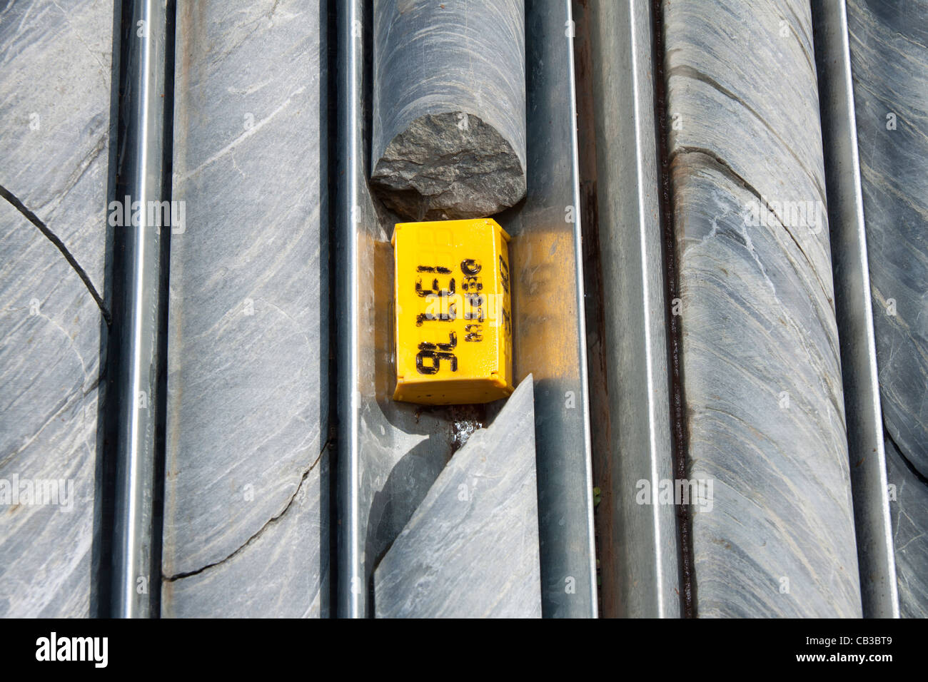 NQ diamond drill core waiting to be logged. - Stock Image