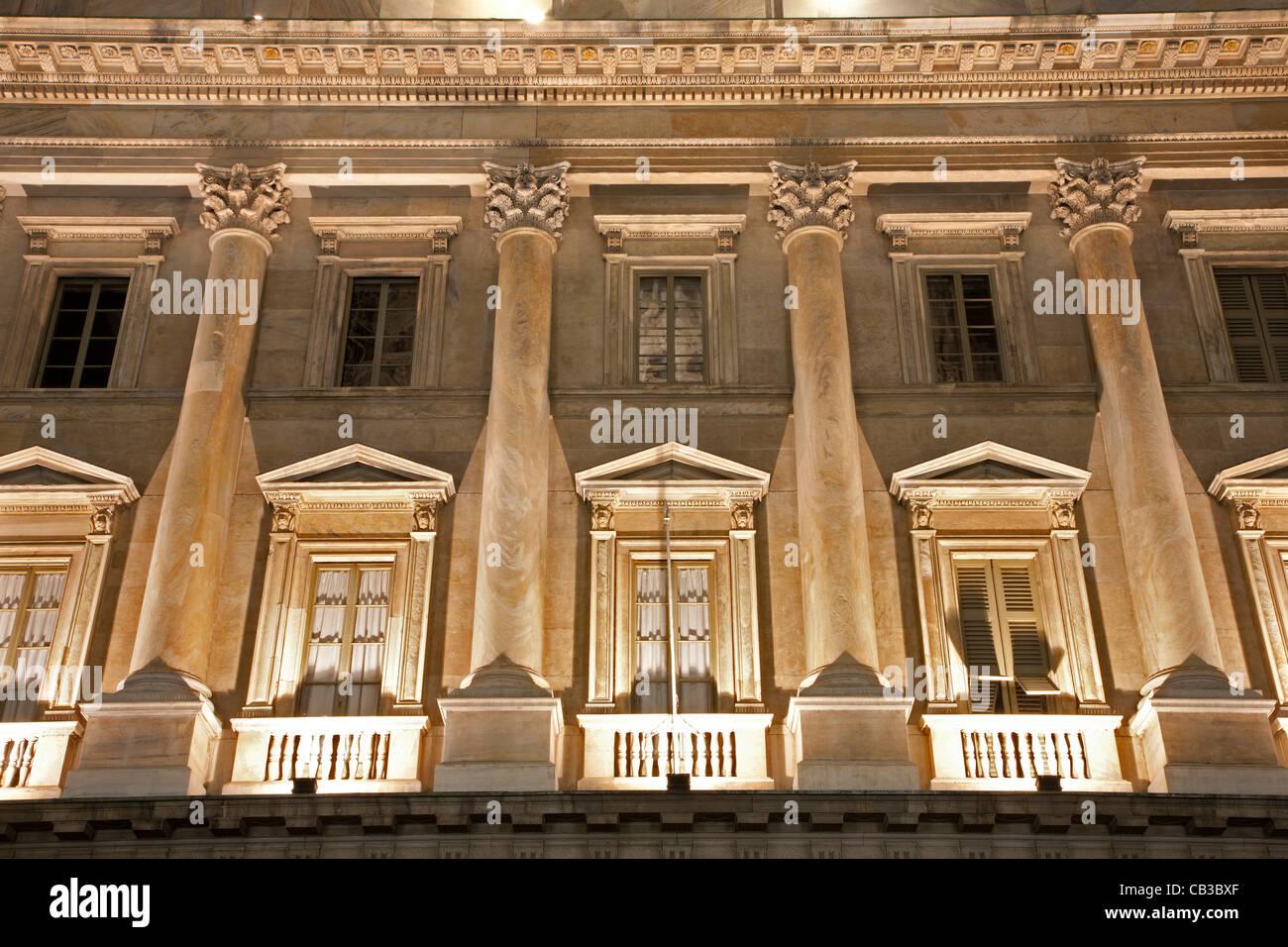 Milan - detail from palace facade at night - Stock Image