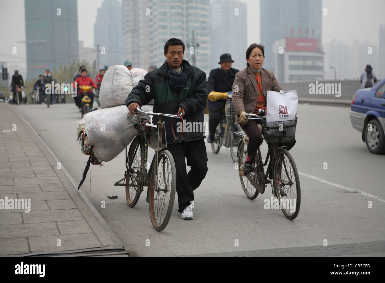 Chinese migrant workers crossing bridge in central Shanghai, China, Asia Stock Photo