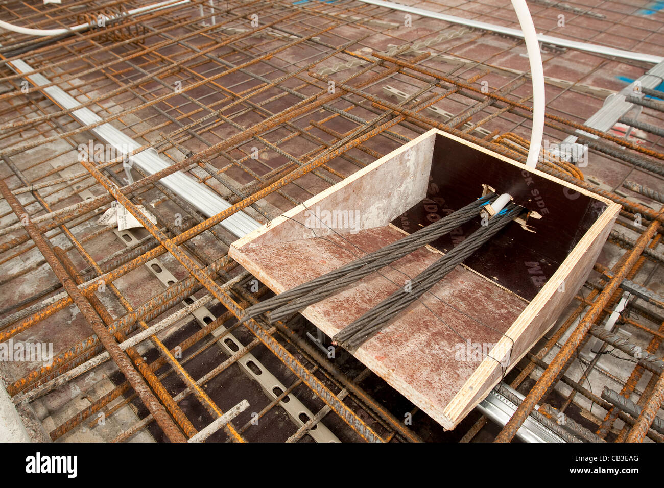 Post-tensioning steel cables in concrete floor formwork Stock Photo