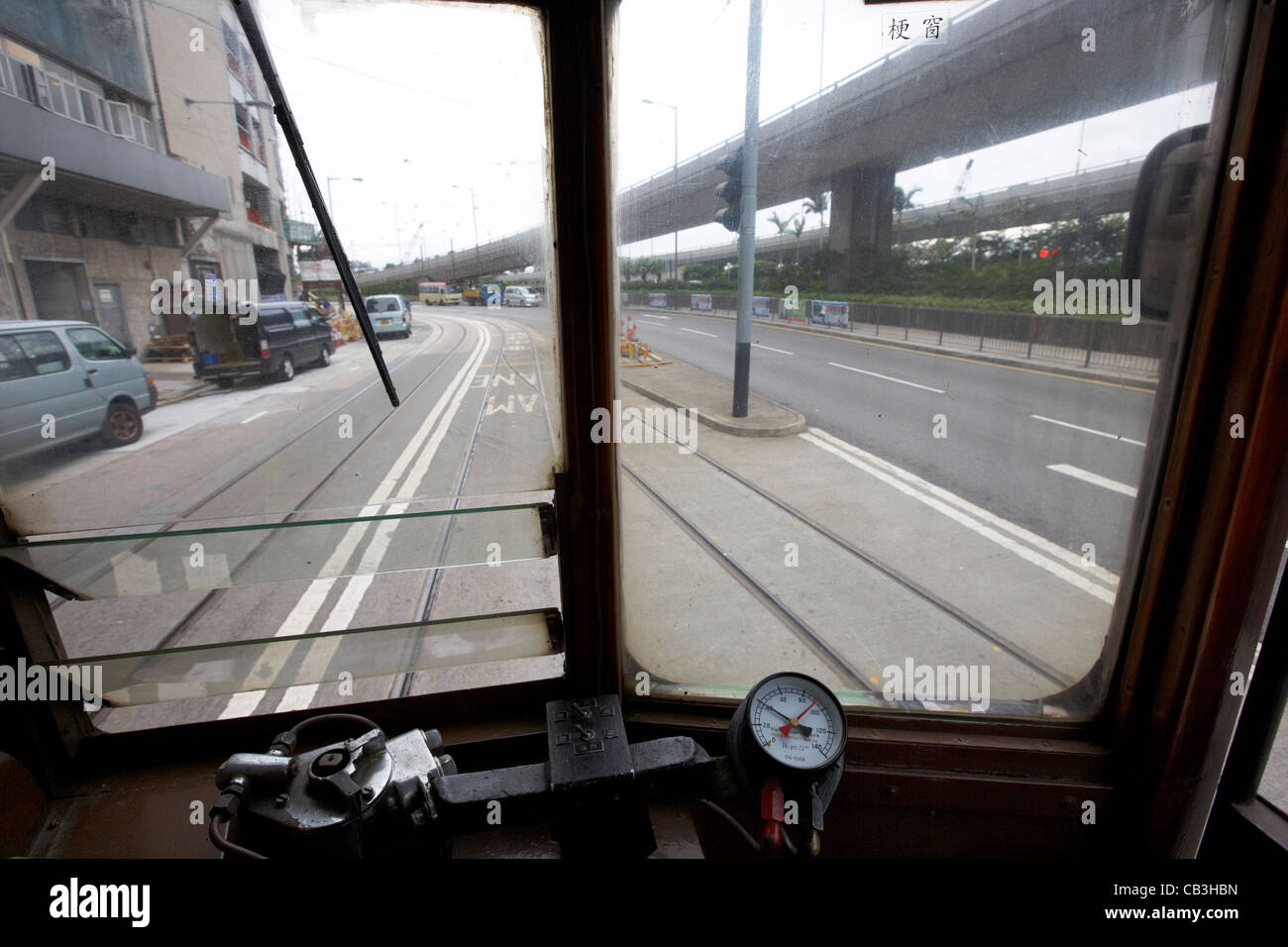looking out of rear window of old hong kong tram on hong kong island hksar china - Stock Image